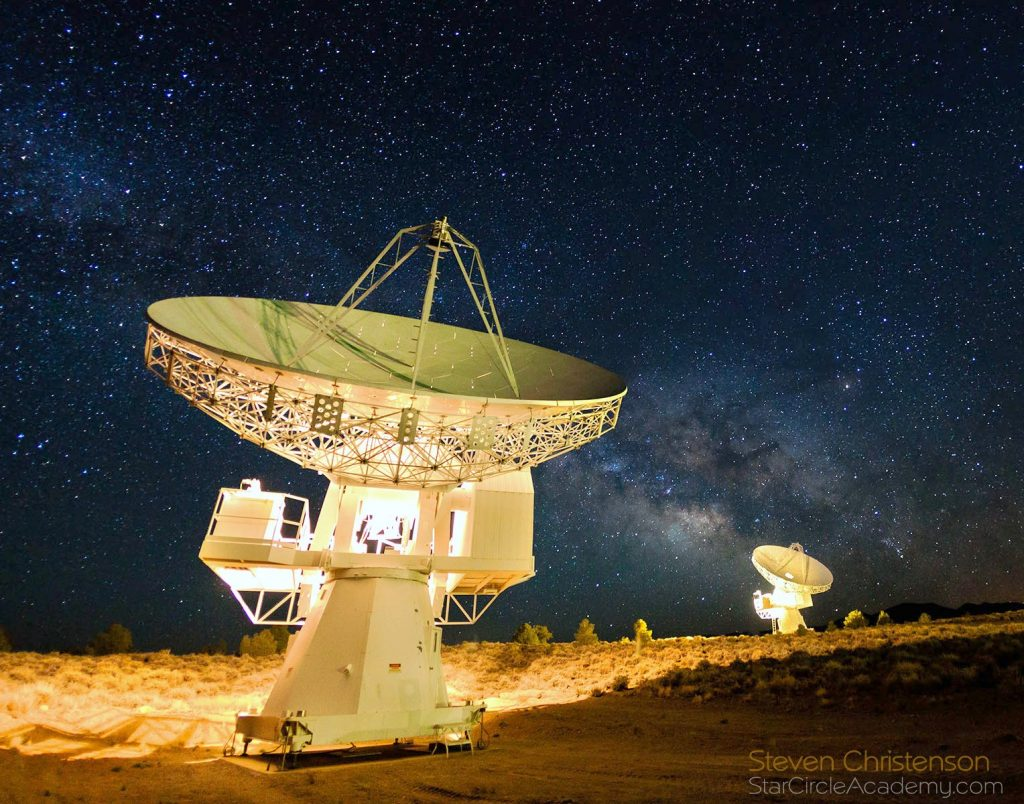 The Milky Way rises over the 10.4 meter radio telescopes at Cedar Flat, California.